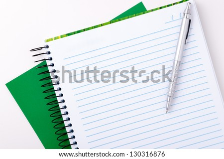 Blank spiral notebook with pen for notes