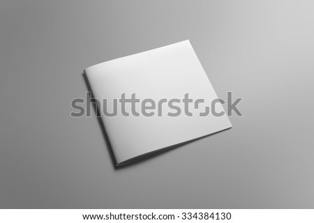 Blank square brochure magazine isolated on grey, with clipping path, changeable background #334384130