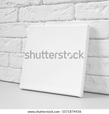 Blank square canvas against the wall. Mockup poster.