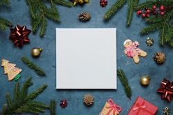 Blank square canvas, Christmas concept. Mockup poster and Christmas decoration, top view.