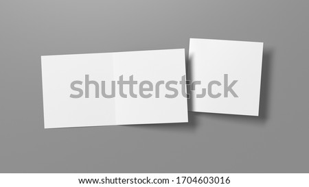 Blank square pages leaflet on gray background. Bi-fold or half-fold opened and folded brochure isolated with clipping path. View directly above. 3d illustration