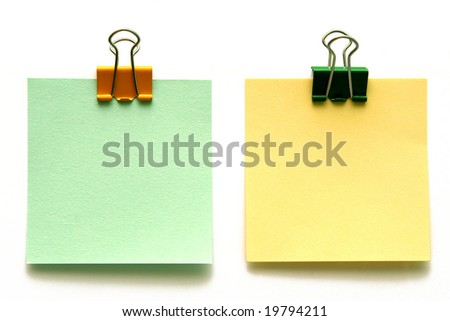 Blank square papers with binders isolated on white. - stock photo