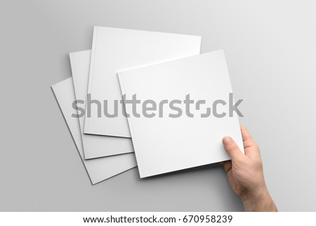 Blank square photorealistic brochure mockup on light grey background.  #670958239