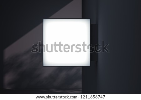 Blank square store signboard Mockup. Empty illuminated shop lightbox template mounted on the wall with trees shadows on background. Street sign, signage, 3d rendering.
