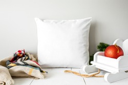 Blank square white throw pillow with christmas decor, holiday home decor mockup
