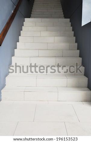 Blank stairways with wood railing.Stairway to the dark