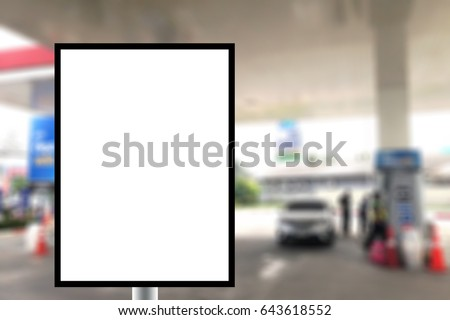 Blank standing sign with copy space for text message or mock up content in Abstract blur background of gas station