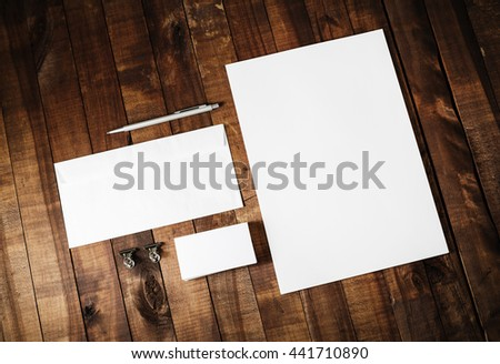 Blank stationery set. Blank corporate identity template on vintage wooden table background. Blank letterhead, business cards, envelope and pen. Mock-up for branding identity. #441710890