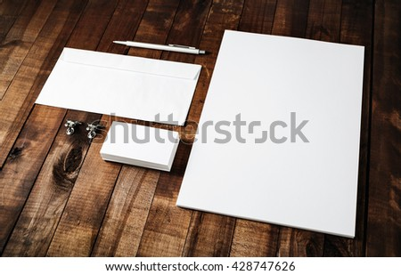 Blank stationery set on vintage wooden table background. Mock-up for branding identity. Blank template for design portfolios. Letterhead, business cards, envelope and pen. #428747626