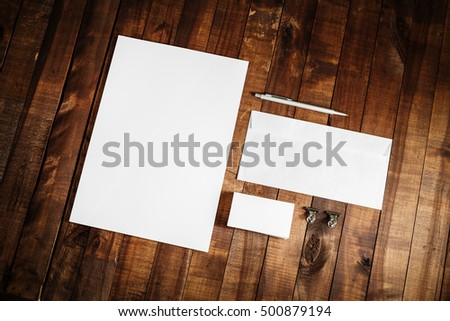 Blank stationery set on wooden table background. Blank paperwork template for design presentations and portfolios. Mock up for branding identity. Top view. #500879194