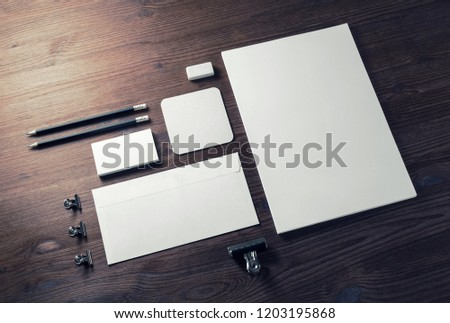 Blank stationery set on wooden table background. ID template. Mockup for branding identity for designers. #1203195868