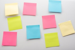 blank Sticker notes on the white background. Mockup sticky Note Paper. empty sheets for notes on a white bulletin board