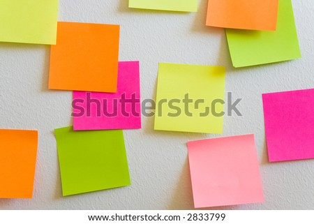 Blank sticky notes attached to a white wall