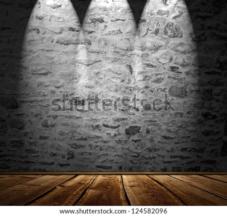 Blank stonewall with spotlights and wooden floor