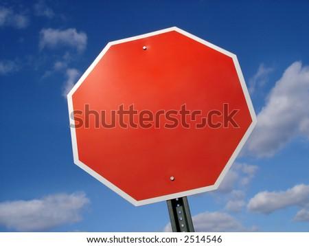 Blank stop sign frame against blue sky.
