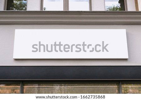 Blank store signage sign design mockup isolated, Clear shop template. Street hanging mounted on the wall. Signboard for logo presentation. Metal cafe restaurant bar plastic badge black white.  Сток-фото ©