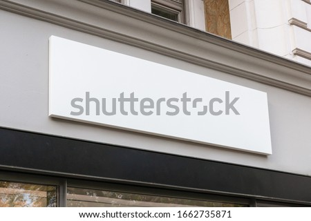 Blank store signage sign design mockup isolated, Clear shop template. Street hanging mounted on the wall. Signboard for logo presentation. Metal cafe restaurant bar plastic badge black white.  Stockfoto ©