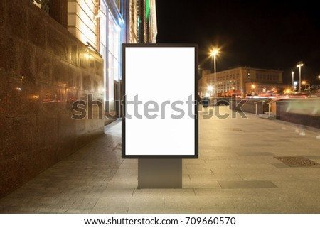 Blank street billboard at night city. Isolated with clipping path around advertising display. 3d illustration. - Shutterstock ID 709660570