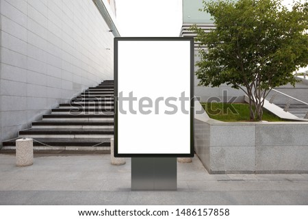 Blank street billboard poster stand mock up in downtown. 3d illustration.