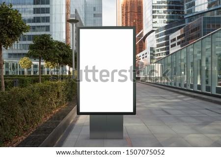 Blank street billboard poster stand mock up on city business district background. 3d illustration.