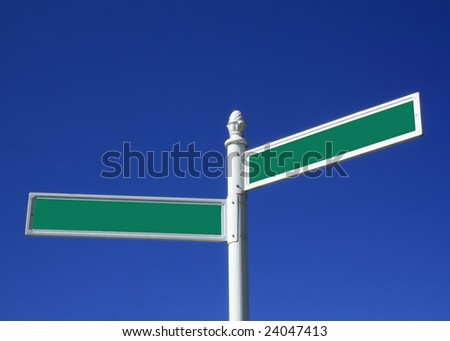 Blank street sign against a blue sky