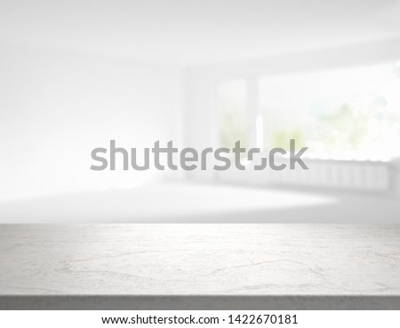 blank table top in front of blurry room - 3D Illustration