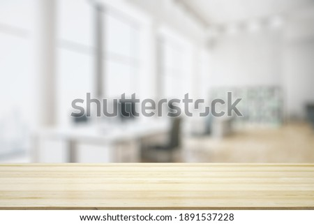 Blank tabletop made of wooden planks with light contemporary furnished office on background, mockup