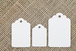 Blank tag on burlap background