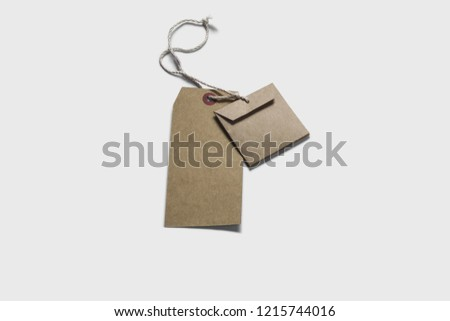 Blank tags tied with string. Price tag, gift tag, sale tag, address label iMock-up isolated on soft gray background.