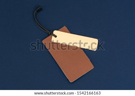 Blank tags tied with string. Price tag, gift tag, sale tag isolated on the blue background. #1542166163