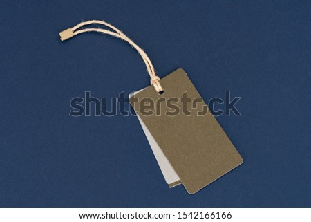 Blank tags tied with string. Price tag, gift tag, sale tag isolated on the blue background. #1542166166