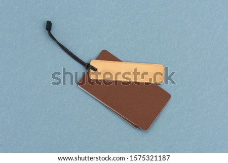 Blank tags tied with string. Price tag, gift tag, sale tag isolated on the blue background. #1575321187