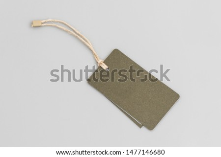 Blank tags tied with string. Price tag, gift tag, sale tag isolated on the gray background.
