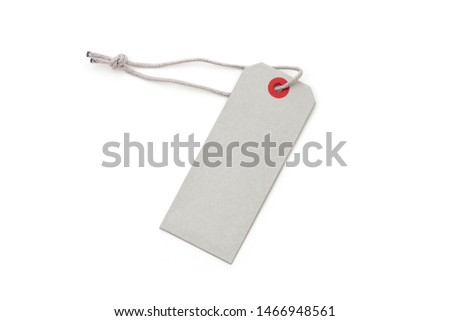 Blank tags tied with string. Price tag, gift tag, sale tag isolated on white background.