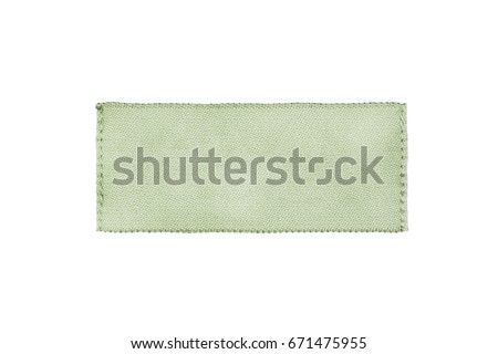 Blank textile green clothes label isolated over white #671475955