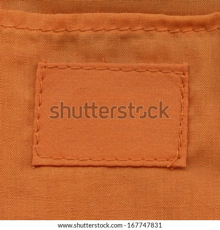 Blank textile textured label. Fragment of texture with pure label for your text.