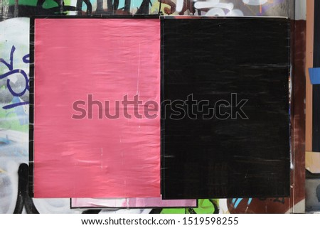 Blank textured street posters on grungy city wall. Background frame design element to overlay your photos and text.