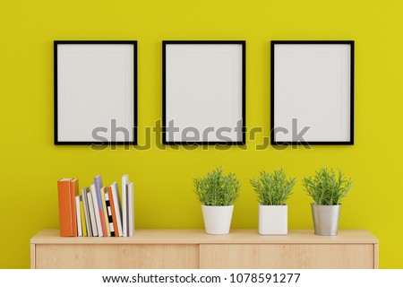 Blank three picture frame for insert text or image inside on the wall in living room.
