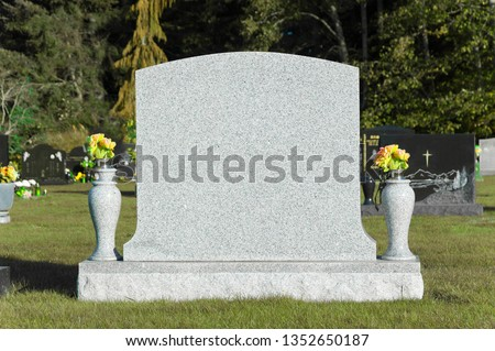Blank tombstone in cemetery ストックフォト ©