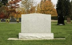 Blank Tombstone in colorful cemetery