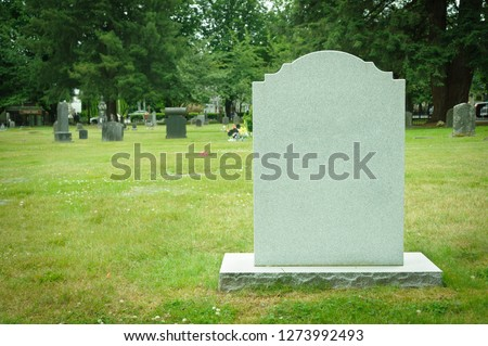 Blank tombstone in old cemetery ストックフォト ©