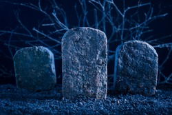 blank tombstone in the dark night at graveyard, halloween background