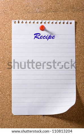 Blank torn paper with the word recipe as header pinned on board. Ready for your text.