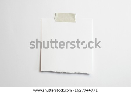 Blank torn polaroid photo frame with soft shadows and scotch tape isolated on white paper background as template for graphic designers presentations, portfolios etc. Stock foto ©