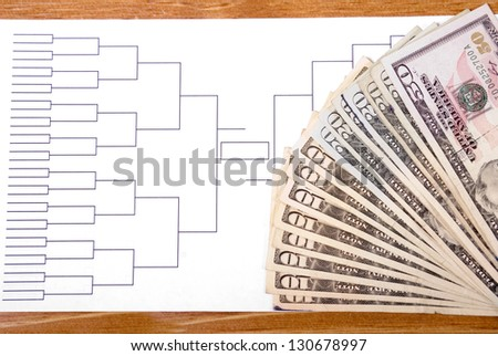 Blank tournament bracket with fanned money representing gambling