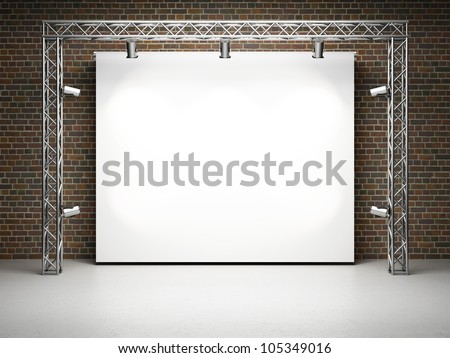 Blank trade exhibition stand with screen and spot lights on brick wall