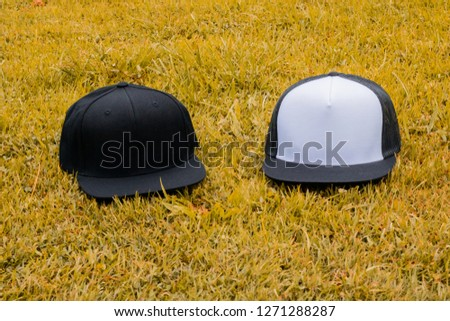 c8406bec9af67 Blank trucker hat and snapback hat cap flat visor with black and white color  in outdoor