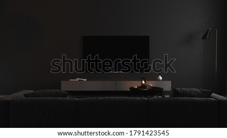 Blank TV screen in modern dark interior with gray sofa in darkness mock up, front view. TV in living room interior background, empty TV display template, 3d render
