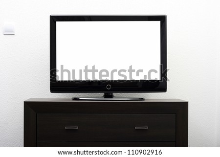 blank tv screen on brown commode against white wall