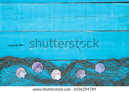 Blank Vacation Sign With Seashells And Fish Netting Border On Antique Rustic Teal Blue Background